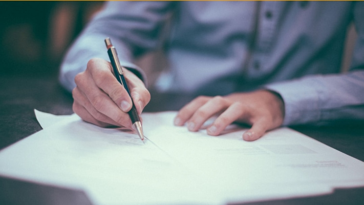 Divorce Attorney writing on his documents