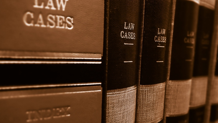 criminal attorney law cases pile of books