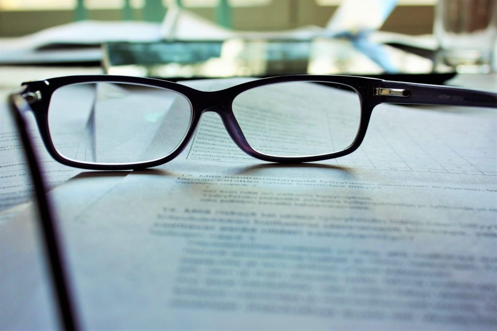 photo of glasses on legal document